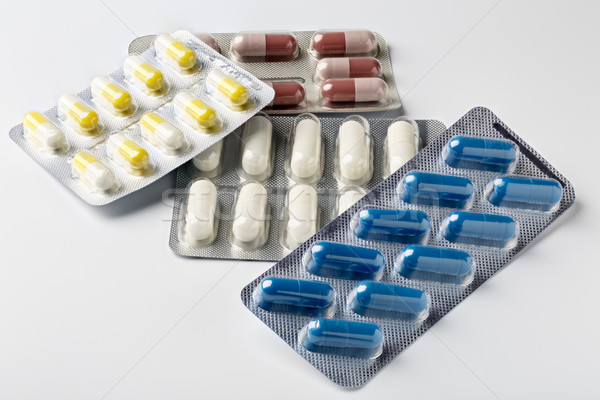 Pill blister pack with colorful capsules and pills Stock photo © ironstealth