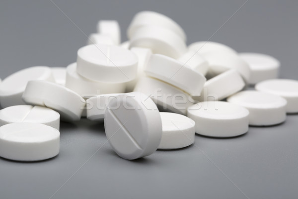 Heap of white round pills medical Stock photo © ironstealth