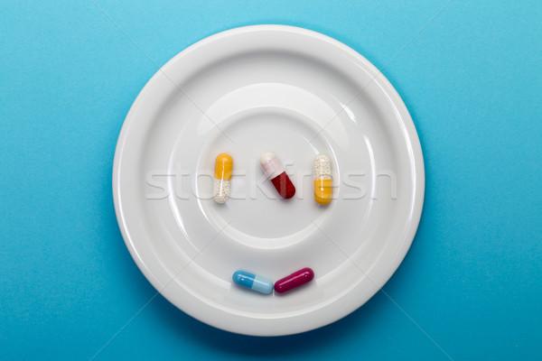 пять красочный капсулы пластина синий здоровья Сток-фото © ironstealth