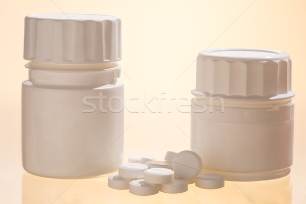 Pill bottles and round white tablets Stock photo © ironstealth