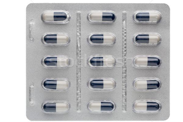 Közelkép sötét kék fehér kapszulák gyógyszer Stock fotó © ironstealth