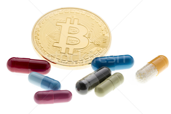 Payment for treatment in the future.Bitcoin and colored pills Stock photo © ironstealth