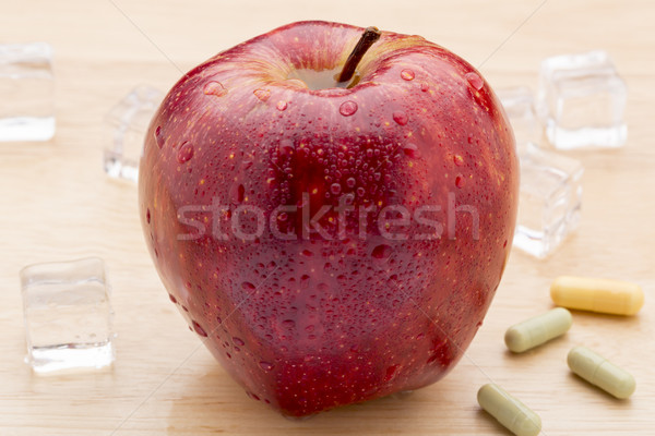 Colorful medicine capsules and red apple Stock photo © ironstealth