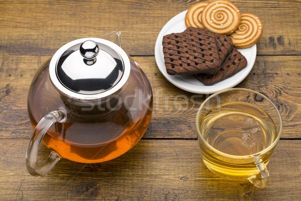 Vidrio taza té verde tetera cookies Foto stock © ironstealth