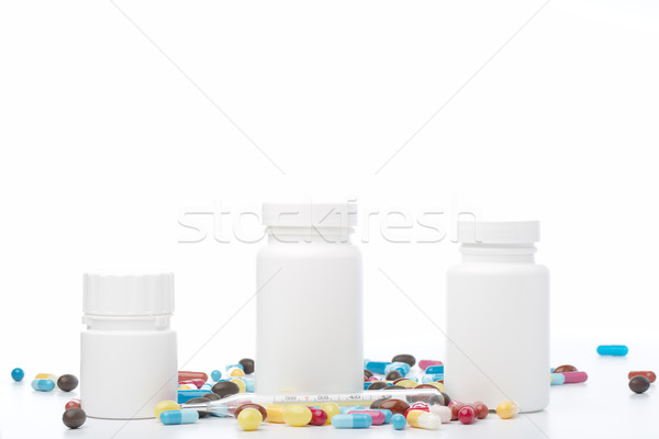 White pill bottle and colorful pills on white background Stock photo © ironstealth