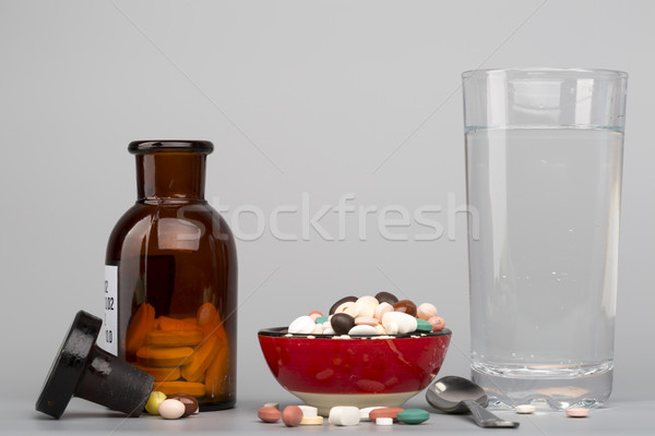 Various pills,medical bottle and glass of water Stock photo © ironstealth