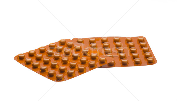 медицина оранжевый таблетки изолированный белый здоровья Сток-фото © ironstealth