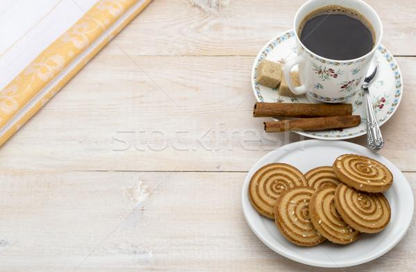 Tasse café cookies lumineuses bois fond Photo stock © ironstealth