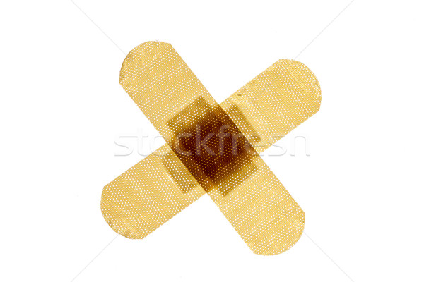 Patch in cross shape, isolated on white background Stock photo © ironstealth