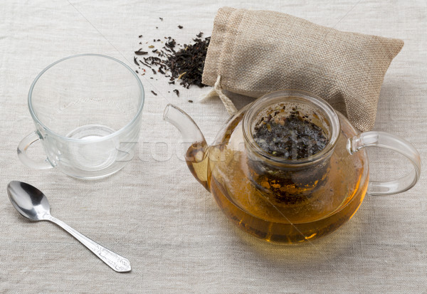 Empty tea cup and the teapot with freshly brewed tea Stock photo © ironstealth