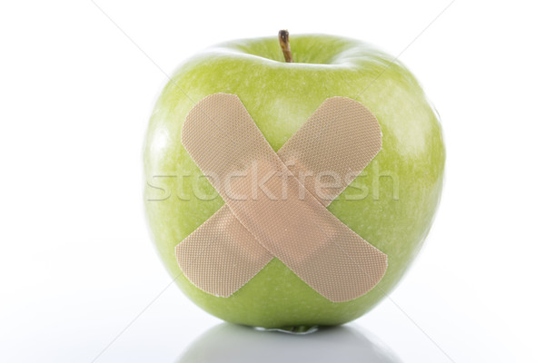 Green apple with a band-aid Stock photo © ironstealth