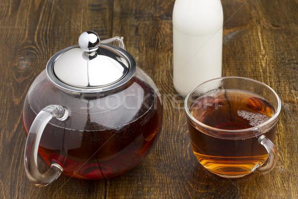 Conjunto vidro bule xícara de chá garrafa leite Foto stock © ironstealth