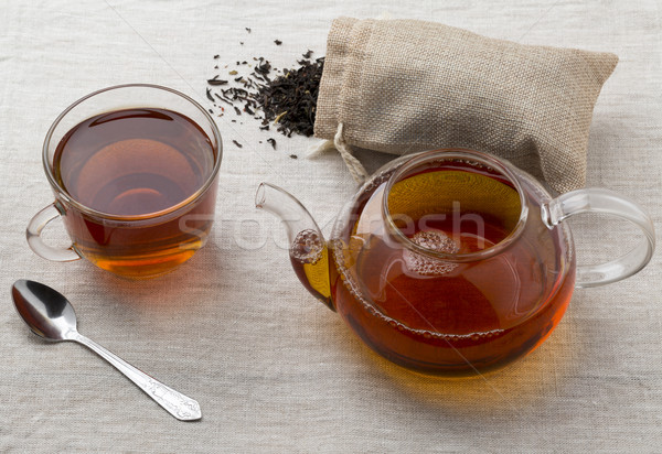 Glass cup and teapot freshly brewed black tea Stock photo © ironstealth
