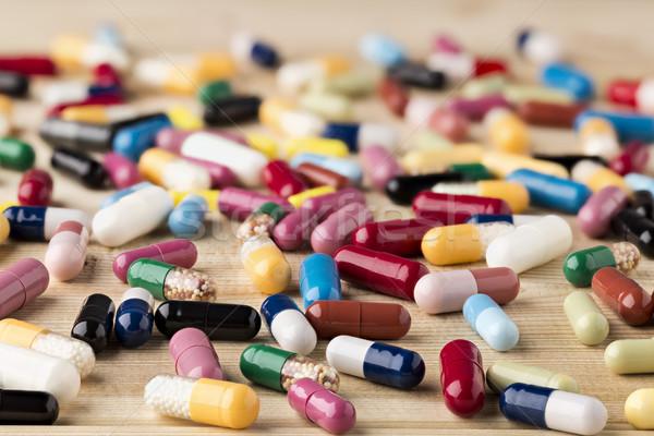 куча медицина капсулы таблетки красочный наркотики Сток-фото © ironstealth