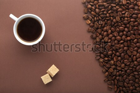 Coffee cup,brown sugar and beans on a brown background. Stock photo © ironstealth