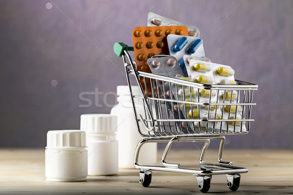 Shopping cart filled with blister packs of pills Stock photo © ironstealth