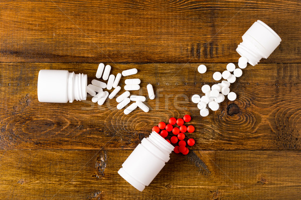 Various medicine bottles and heap from different pills Stock photo © ironstealth