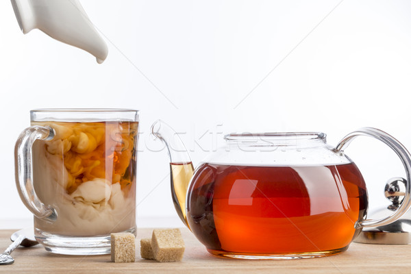 Dissolve milk in a cup of black tea. Stock photo © ironstealth