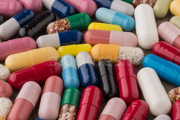куча различный красочный капсулы медицинской таблетки Сток-фото © ironstealth