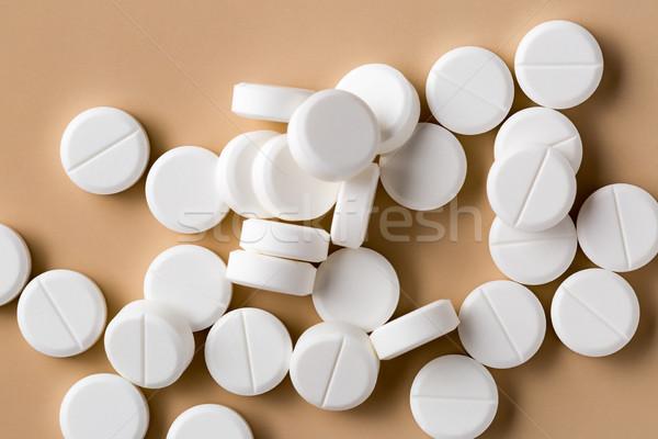 Heap of round white pills Stock photo © ironstealth