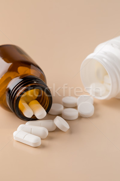 Glass and plastic pills bottle Stock photo © ironstealth