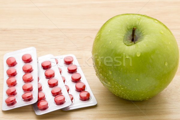 Red pills blister pack and green apple Stock photo © ironstealth