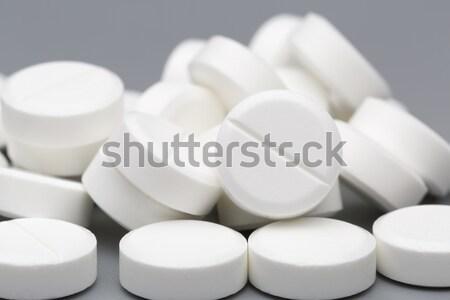 Heap of white round pills Stock photo © ironstealth