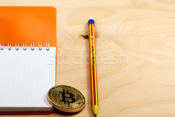 The cryptocurrency bitcoin coin on open notepad. Stock photo © ironstealth