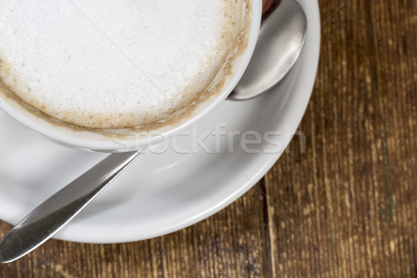 Close up cup of coffee on the wooden table Stock photo © ironstealth