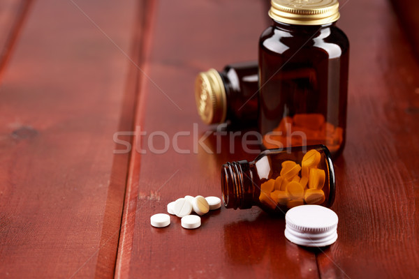 Glass bottle for pills with white tablets Stock photo © ironstealth