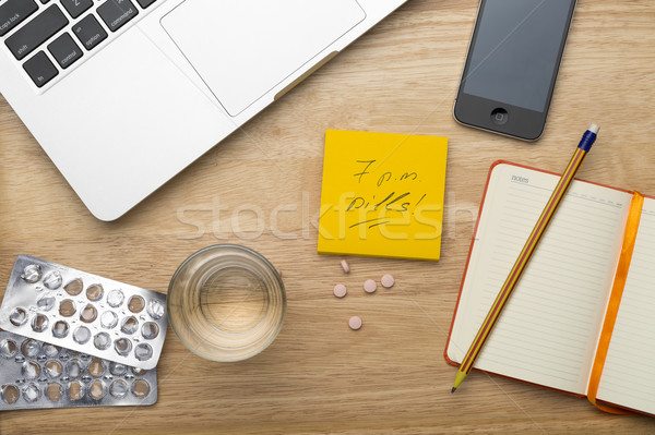 Pills and empty blister pack in the workplace Stock photo © ironstealth