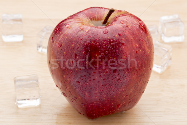 Stock photo: Ripe red apples with water drops on wooden table close up