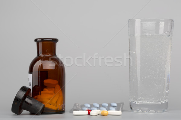 Various pills,medical bottle and glass of fizzy water Stock photo © ironstealth