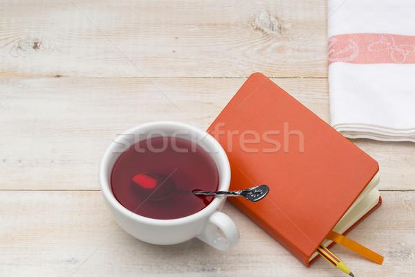 Foto stock: Copo · vermelho · chá · laranja · bloco · de · notas · brilhante