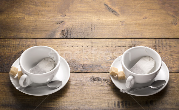 Set of two ceramic tea mugs with sachet Stock photo © ironstealth