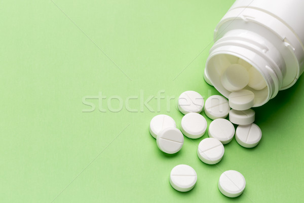 Round white pills and plastic pill bottle Stock photo © ironstealth