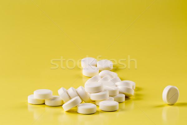 белый таблетки желтый куча медицинской здоровья Сток-фото © ironstealth