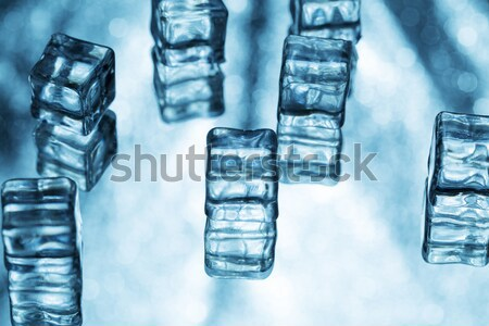 Melting transparent blue ice cubes on glass Stock photo © ironstealth