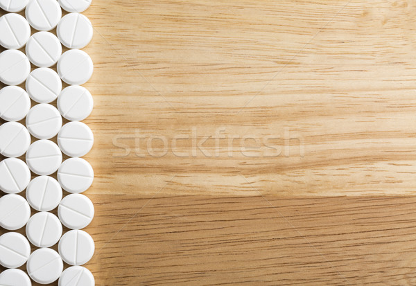 Border from white pills with copy space Stock photo © ironstealth