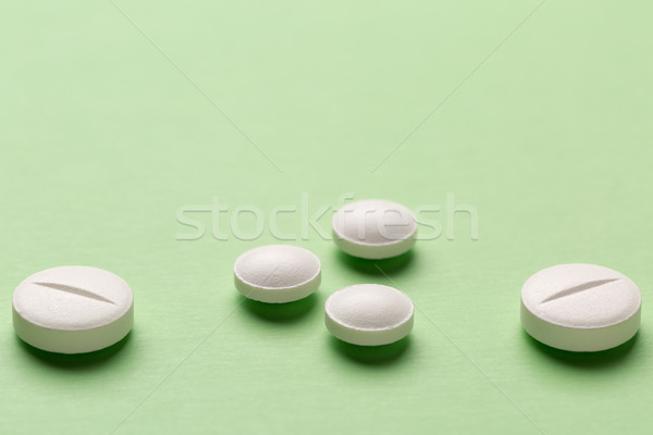 Round white pills on colorful background Stock photo © ironstealth