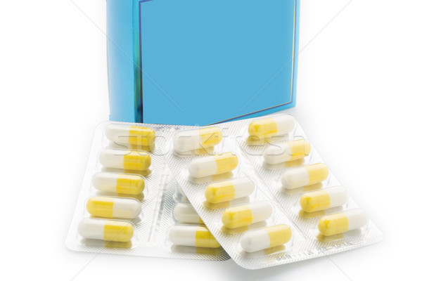 Yellow capsules tablet blister pack and blue pill box Stock photo © ironstealth