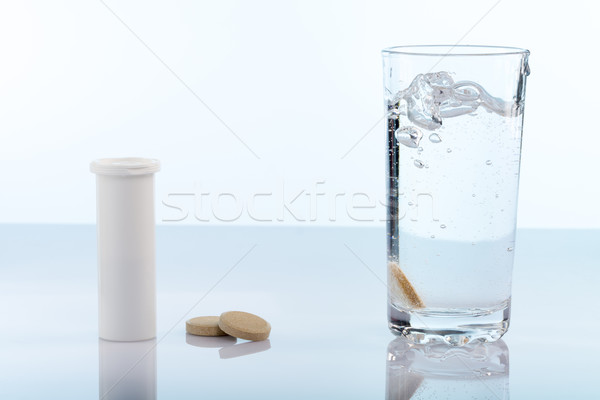 Pilules verre eau bouteille fond Photo stock © ironstealth