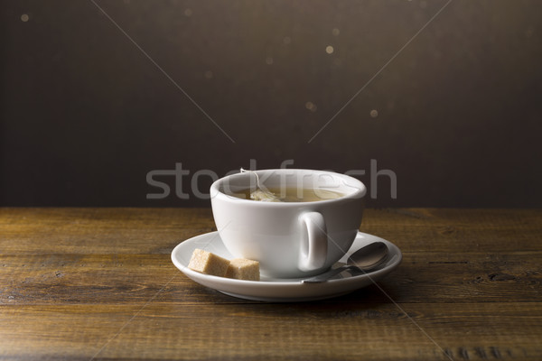 Tea cup with tea bag on saucer Stock photo © ironstealth