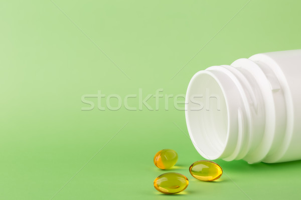 Stock photo: Fish oil pills and a bottle of medicine