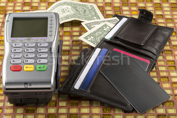 Payment wireless terminal and wallet with dollar banknote Stock photo © ironstealth