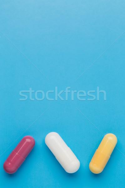 Stockfoto: Drie · gekleurd · pillen · Blauw · medische · gezondheid