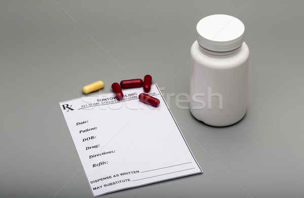 Prescription capsules and pill bottle Stock photo © ironstealth