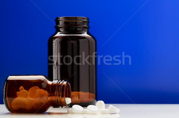 Bottiglie rosolare vetro bianco pillole Foto d'archivio © ironstealth