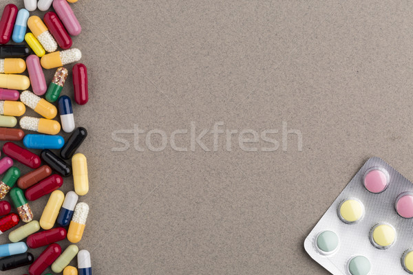Various colorful capsules and pills on brown craft paper Stock photo © ironstealth