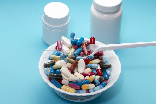 Different pills on a plate and two bottle Stock photo © ironstealth